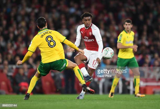 Alex Iwobi of Arsenal knocks the ball past Mario Vrancic of Norwich during the Carabao Cup Fourth Round match between Arsenal and Norwich City at...
