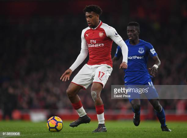 Alex Iwobi of Arsenal passes the ball under pressure from Idrissa Gueye of Everton during the match the Premier League match between Arsenal and...