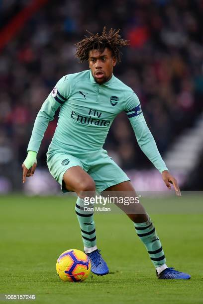 Alex Iwobi of Arsenal runs with the ball during the Premier League match between AFC Bournemouth and Arsenal FC at Vitality Stadium on November 25...