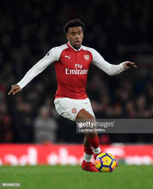 Alex Iwobi of Arsenal runs with the ball during the Premier League match between Arsenal and Manchester United at Emirates Stadium on December 2 2017...