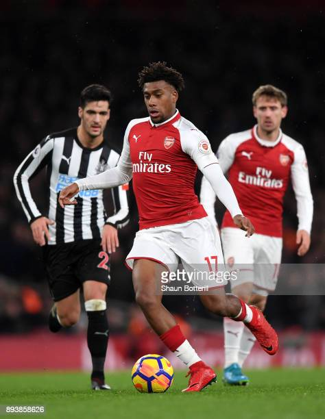 Alex Iwobi of Arsenal runs with the ball during the Premier League match between Arsenal and Newcastle United at Emirates Stadium on December 16 2017...