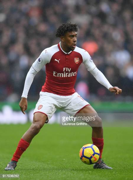 Alex Iwobi of Arsenal runs with the ball during the Premier League match between Tottenham Hotspur and Arsenal at Wembley Stadium on February 10 2018...