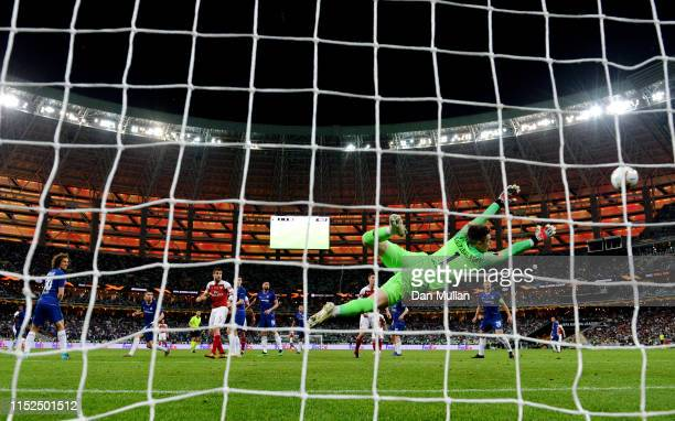 Alex Iwobi of Arsenal scores his sides goal pass goalkeeper Kepa Arrizabalaga of Chelsea during the UEFA Europa League Final between Chelsea and...