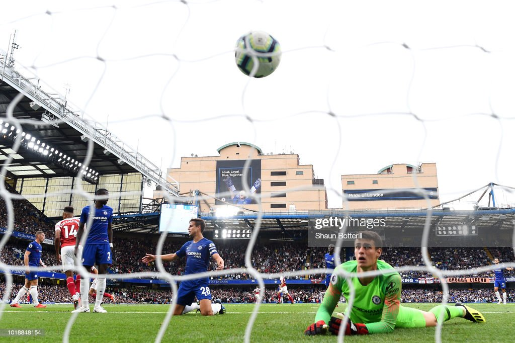 Alex Iwobi of Arsenal (not pictured) scores his side's second goal past Kepa Arrizabalaga of Chelsea during the Premier League match between Chelsea FC and Arsenal FC at Stamford Bridge on August 18, 2018 in London, United Kingdom.