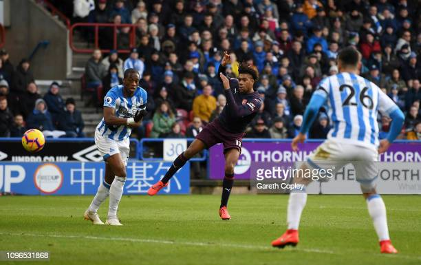 Alex Iwobi of Arsenal scores his team's first goal during the Premier League match between Huddersfield Town and Arsenal FC at John Smith's Stadium...