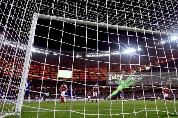 Alex Iwobi of Arsenal scores his team's first goal past Kepa Arrizabalaga of Chelsea during the UEFA Europa League Final between Chelsea and Arsenal...