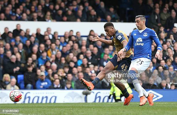 Alex Iwobi of Arsenal scores his team's second goal during the Barclays Premier League match between Everton and Arsenal at Goodison Park on March...
