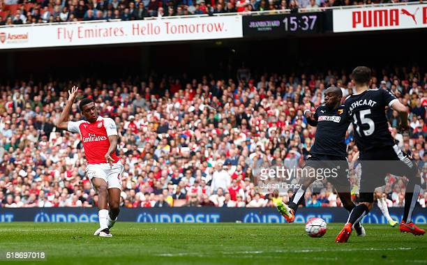 Alex Iwobi of Arsenal scores his team's second goal during the Barclays Premier League match between Arsenal and Watford at Emirates Stadium on April...