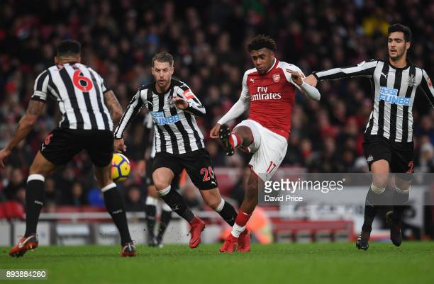 Alex Iwobi of Arsenal shoots under pressure from Florian Lejeune and Mikel Merino of Newcastle during the Premier League match between Arsenal and...