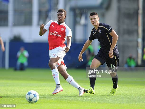 Alex Iwobi of Arsenal takes on Amer Gojak of Dinamo on his way to scoring a goal for Arsenal during the UEFA Youth League match between GNK Dinamo...