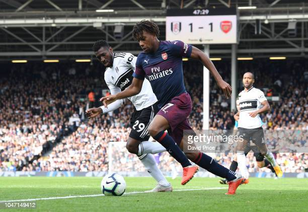 Alex Iwobi of Arsenal takes on AndreFrank Zambo Anguissa of Fulham during the Premier League match between Fulham FC and Arsenal FC at Craven Cottage...