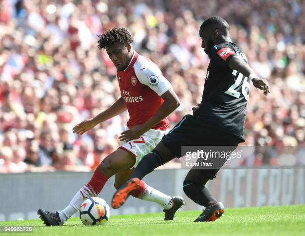 Alex Iwobi of Arsenal takes on Arthur Masuaku of West Ham during the Premier League match between Arsenal and West Ham United at Emirates Stadium on...