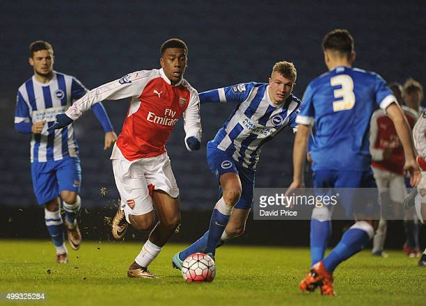 Alex Iwobi of Arsenal takes on Ben Barclay of Brighton during the match between Brighton and Hove Albion U21 and Arsenal U21 at Amex Stadium on...