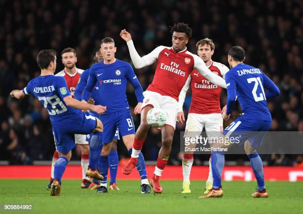 Alex Iwobi of Arsenal takes on Cesar Azpilicueta Ross Barkley and Davide Zappacosta of Chelsea during the Carabao Cup SemiFinal Second Leg between...