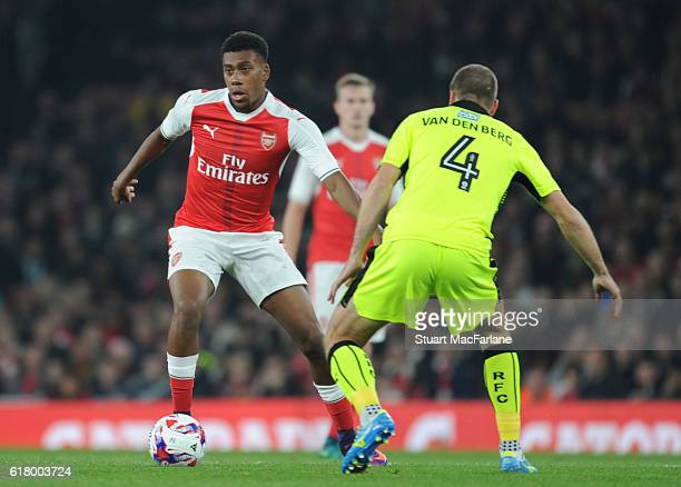 Alex Iwobi of Arsenal takes on Joey Van Den Berg of Reading during the EFL Cup Fourth Round match between Arsenal and Reading at Emirates Stadium on...