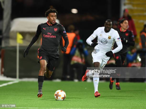 Alex Iwobi of Arsenal takes on Ken Sema of Ostersunds during UEFA Europa League Round of 32 match between Ostersunds FK and Arsenal at the Jamtkraft...