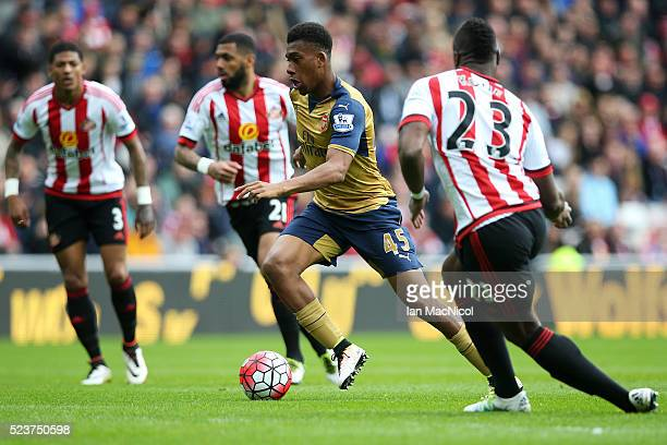 Alex Iwobi of Arsenal takes on the Sunderland defence during the Barclays Premier League match between Sunderland and Arsenal at the Stadium of Light...
