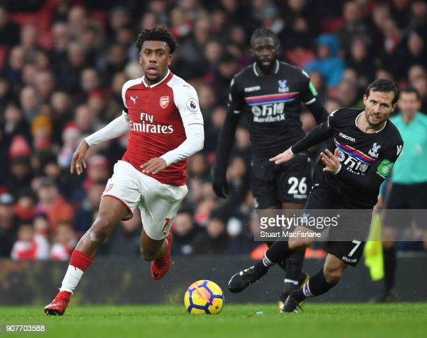 Alex Iwobi of Arsenal takes on Yohan Cabaye of Crystal Palace during the Premier League match between Arsenal and Crystal Palace at Emirates Stadium...