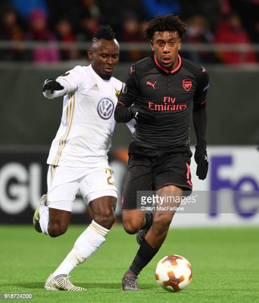 Alex Iwobi of Arsenal takes ony Samuel Mensah of Ostersunds during UEFA Europa League Round of 32 match between Ostersunds FK and Arsenal at the...