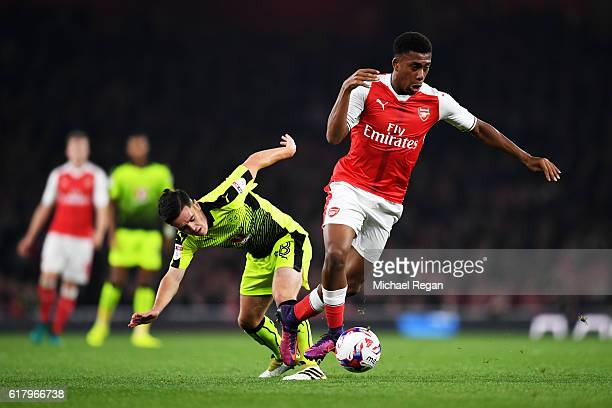 Alex Iwobi of Arsenal takes the ball past Liam Kelly of Reading during the EFL Cup fourth round match between Arsenal and Reading at Emirates Stadium...