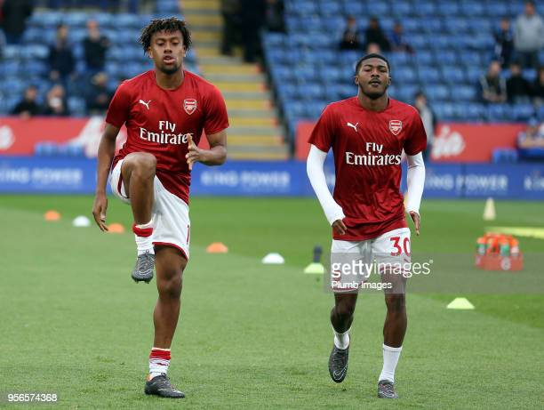 Alex Iwobi of Arsenal warms up alongside Ainsley MaitlandNiles of Arsenal ahead of the Premier League match between Leicester City and Arsenal at...