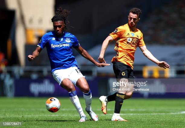 Alex Iwobi of Everton and Diogo Jota of Wolverhampton Wanderers in action during the Premier League match between Wolverhampton Wanderers and Everton...