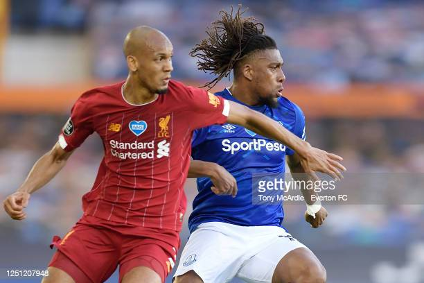 Alex Iwobi of Everton and Fabinho during the Premier League match between Everton and Liverpool at Goodison Park on June 21 2020 in Liverpool England