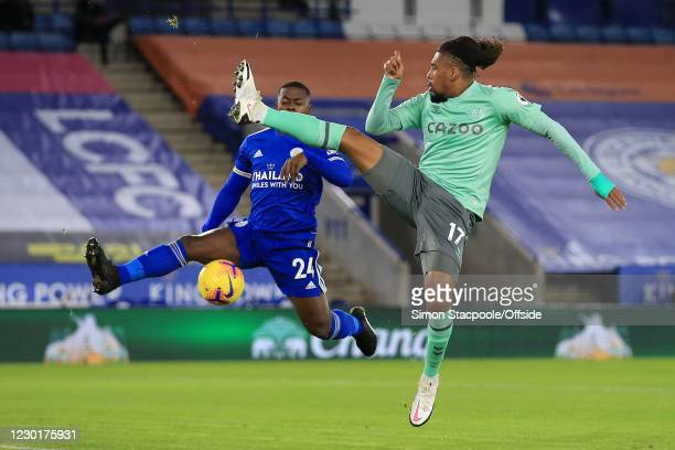 Alex Iwobi of Everton battles with Nampalys Mendy of Leicester during the Premier League match between Leicester City and Everton at The King Power...