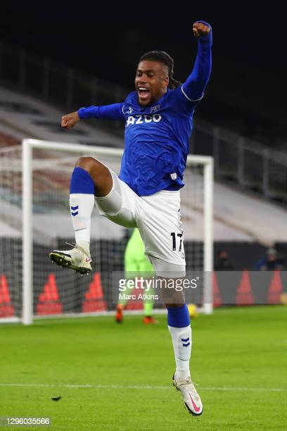 Alex Iwobi of Everton celebrates after scoring his team's first goal during the Premier League match between Wolverhampton Wanderers and Everton at...