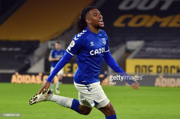 Alex Iwobi of Everton celebrates after scoring their team's first goal during the Premier League match between Wolverhampton Wanderers and Everton at...