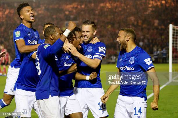 Alex Iwobi of Everton celebrates his goal with Djibril Sidibi Mason Holgate Gylfi Sigurdsson and Cenk Tosun during the Carabao Cup Second Round match...