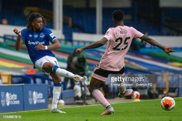 Alex Iwobi of Everton crosses the ball past Wilfred Ndidi of Leicester City during the Premier League match between Everton FC and Leicester City at...
