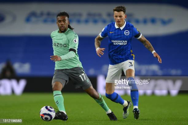 Alex Iwobi of Everton is challenged by Ben White of Brighton & Hove Albion during the Premier League match between Brighton & Hove Albion and Everton...