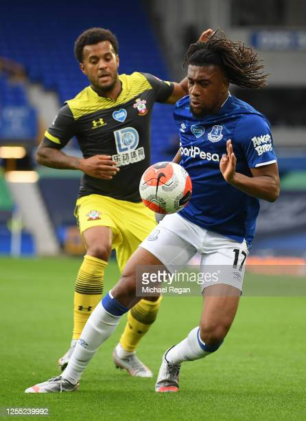 Alex Iwobi of Everton is challenged by Ryan Bertrand of Southampton during the Premier League match between Everton FC and Southampton FC at Goodison...