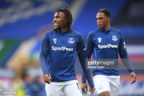 Alex Iwobi of Everton looks on as he warms up prior to the Premier League match between Everton FC and Southampton FC at Goodison Park on July 09...