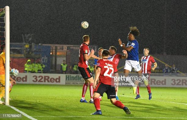 Alex Iwobi of Everton scores his team's third goal during the Carabao Cup Second Round match between Lincoln City and Everton at Sincil Bank Stadium...