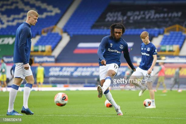 Alex Iwobi of Everton shoots as he warms up prior to the Premier League match between Everton FC and Southampton FC at Goodison Park on July 09 2020...