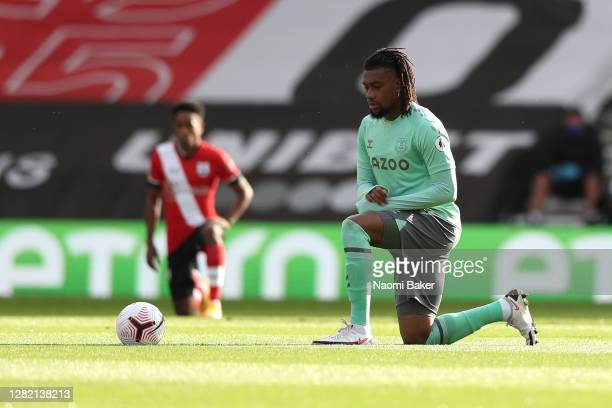 Alex Iwobi of Everton takes a knee in support of the Black Lives Matter movement prior to the Premier League match between Southampton and Everton at...