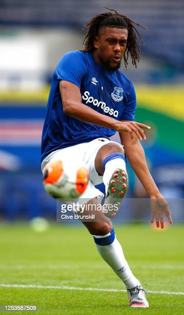 Alex Iwobi of Everton warms up ahead of the Premier League match between Everton FC and Leicester City at Goodison Park on July 01 2020 in Liverpool...