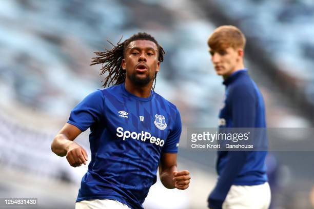Alex Iwobi of Everton warms up ahead of the Premier League match between Tottenham Hotspur and Everton FC at Tottenham Hotspur Stadium on July 06...