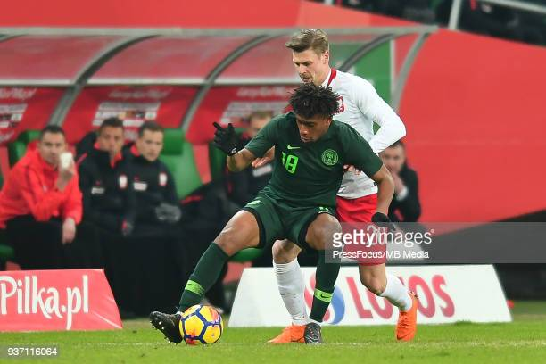 Alex Iwobi of Nigeria competes with Lukasz Piszczek of Poland during the international friendly match between Poland and Nigeria at the Municipal...