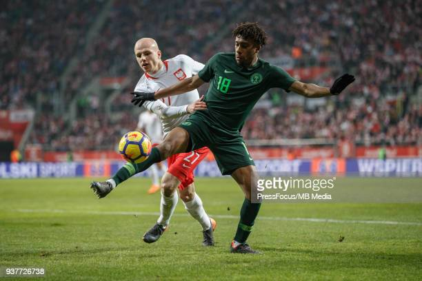 Alex Iwobi of Nigeria competes with Rafal Kurzawa of Poland during the international friendly match between Poland and Nigeria at the Municipal...