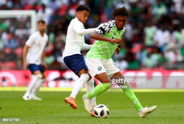 Alex Iwobi of Nigeria is challenged by Jessie Lingard of England during the International Friendly match between England and Nigeria at Wembley...
