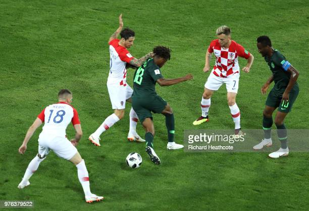 Alex Iwobi of Nigeria is stopped by Sime Vrsaljko and Ante Rebic under the eyes Ivan Rakitic of Croatia and John Obi Mikel of Nigeria during the 2018...