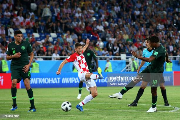 Alex Iwobi of Nigeria shoots past Andrej Kramaric of Croatia during the 2018 FIFA World Cup Russia group D match between Croatia and Nigeria at...