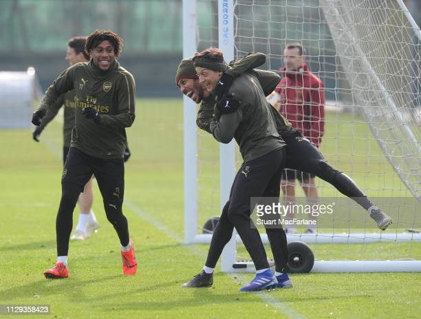 Alex Iwobi PierreEmerick Aubameyang and Mesut Ozil of Arsenal during a training session at London Colney on February 13 2019 in St Albans England