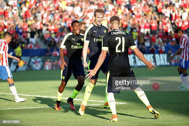 Alex Iwobi Rob Holding and Calum Chambers of Arsenal celebrate Holding's first half goal against Chivas de Guadalajara at StubHub Center on July 31...