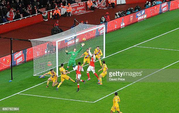 Alex Iwobi scores Arsenal's 2nd goal past Wayne Hennessey of Palace during the Premier League match between Arsenal and Crystal Palace at Emirates...