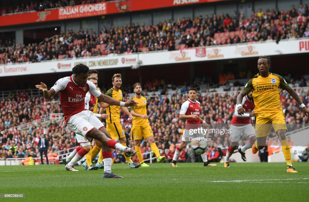 Alex Iwobi scores Arsenal's second goal during the Premier League match between Arsenal and Brighton and Hove Albion at Emirates Stadium on October 1, 2017 in London, England.