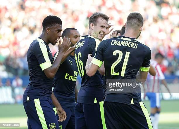 Alex Iwobi Theo Walcott Rob Holding and Calum Chambers of Arsenal celebrate Holding's first half goal against Chivas de Guadalajara at StubHub Center...